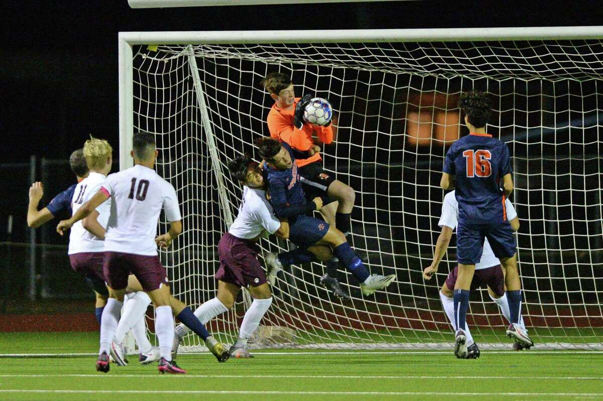 Goal Keeper Sean Paxton (1) of Seven Lakes makes a save during the first half of a 6A-III District 19 soccer match between the Seven Lakes Spartans and the Cinco Ranch Cougars on Friday, March 12, 2021 at Seven Lakes HS, Katy, TX.