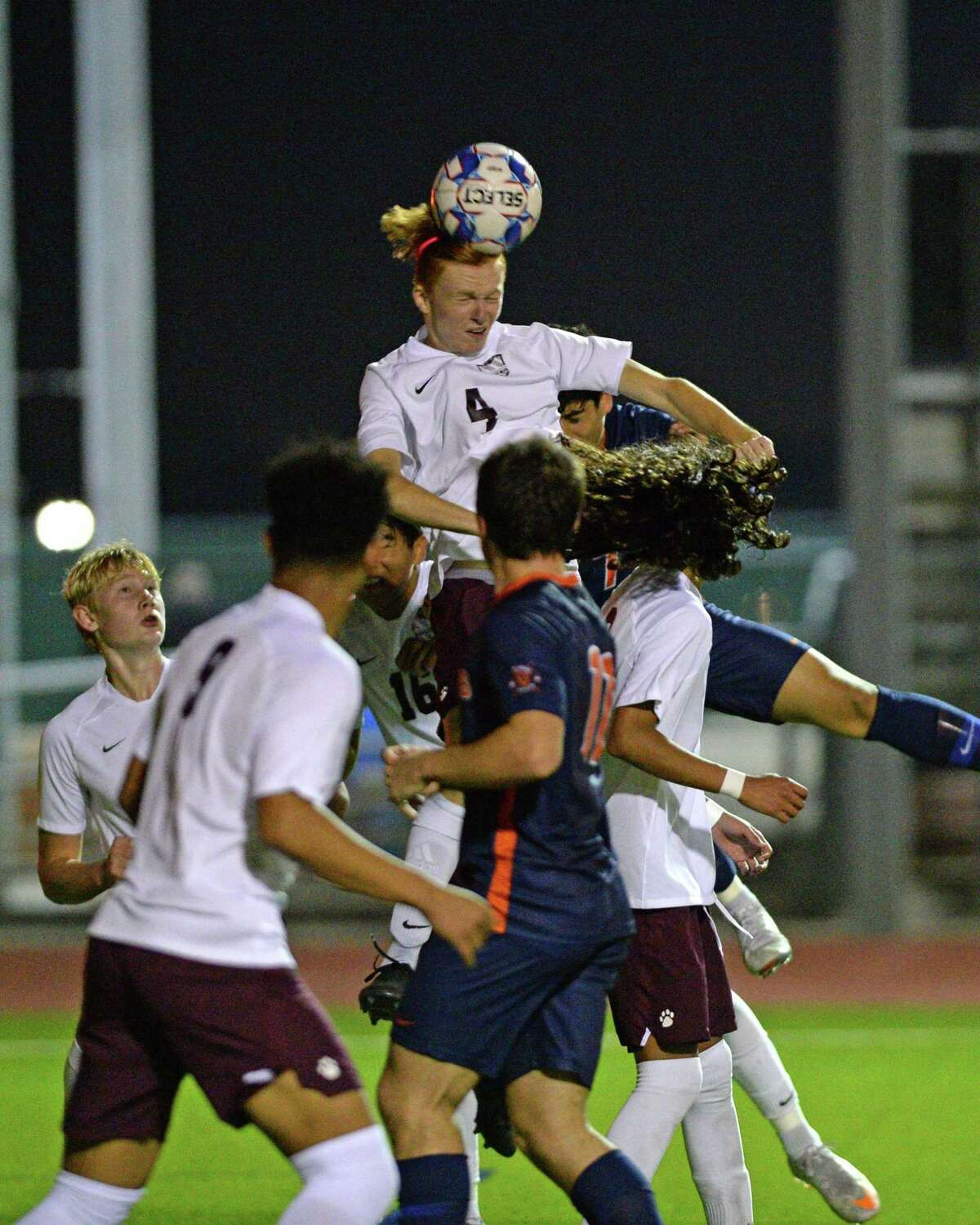 Jake Manzi (4) of Cinco Ranch heads a ball during the first half of a 6A-III District 19 soccer match between the Seven Lakes Spartans and the Cinco Ranch Cougars on Friday, March 12, 2021 at Seven Lakes HS, Katy, TX.
