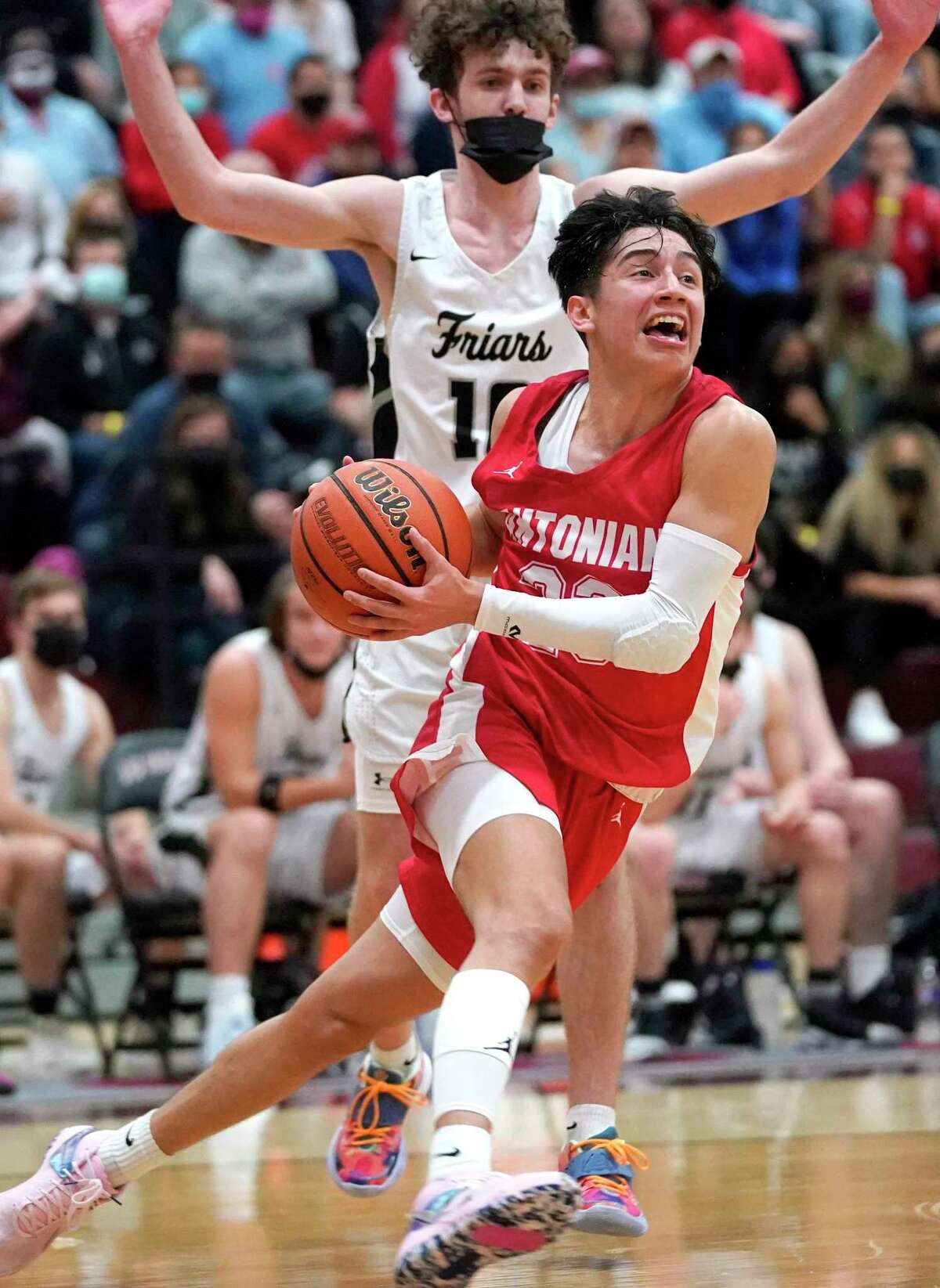 Antonian College Prep's Xavier Martinez (23) drives past Dallas Bishop Lynch's Robert Teal (10) during the TAPPS 6A boys basketball championship game at A&M Consolidated High School in College Station, Texas on Friday, March 12, 2021. (Sam Craft/Special Contributor)