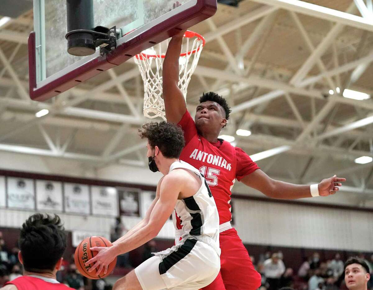 Antonian College Prep's Bryon Armstrong (15) tries to block a shot attempt by Dallas Bishop Lynch's Robert Teal (10) during the TAPPS 6A boys basketball championship game at A&M Consolidated High School in College Station, Texas on Friday, March 12, 2021. (Sam Craft/Special Contributor)