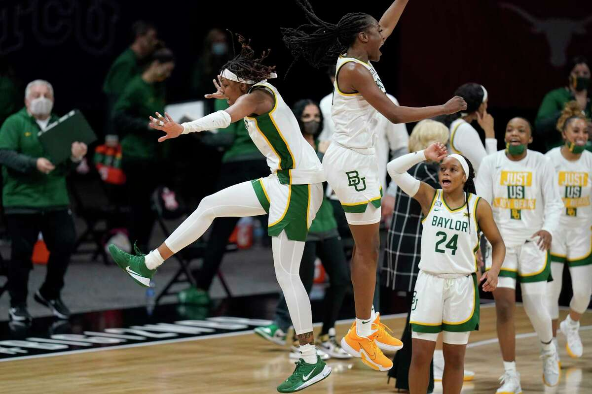 Baylor's NaLyssa Smith, left, and Queen Egbo celebrate after the Lady Bears beat Texas in the Big 12 semifinals. Smith and Egbo combined for 31 points, 32 rebounds and three blocks.