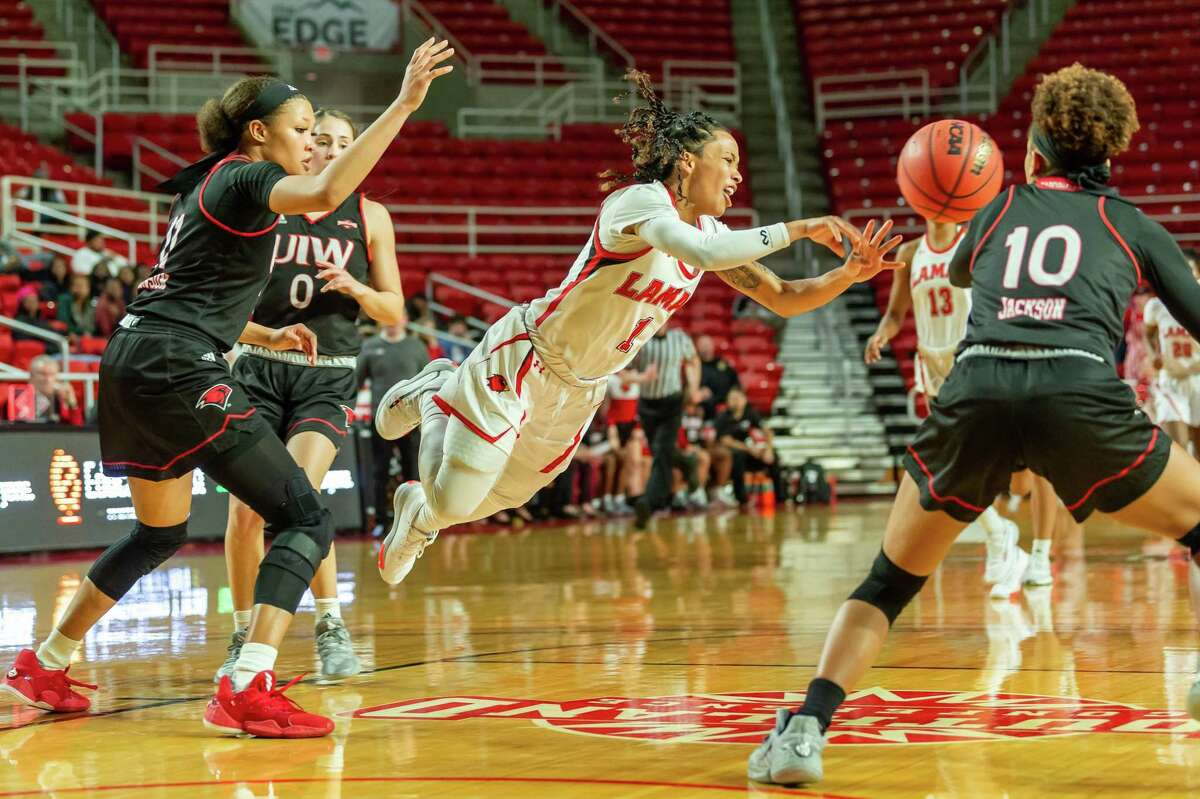 Jadyn Pimentel (1) goes airborne with a pass in the second half as the Lady Cardinals fell to the Cardinals of the University of the Incarnate Word on Wednesday, January 22, 2020. Fran Ruchalski/The Enterprise