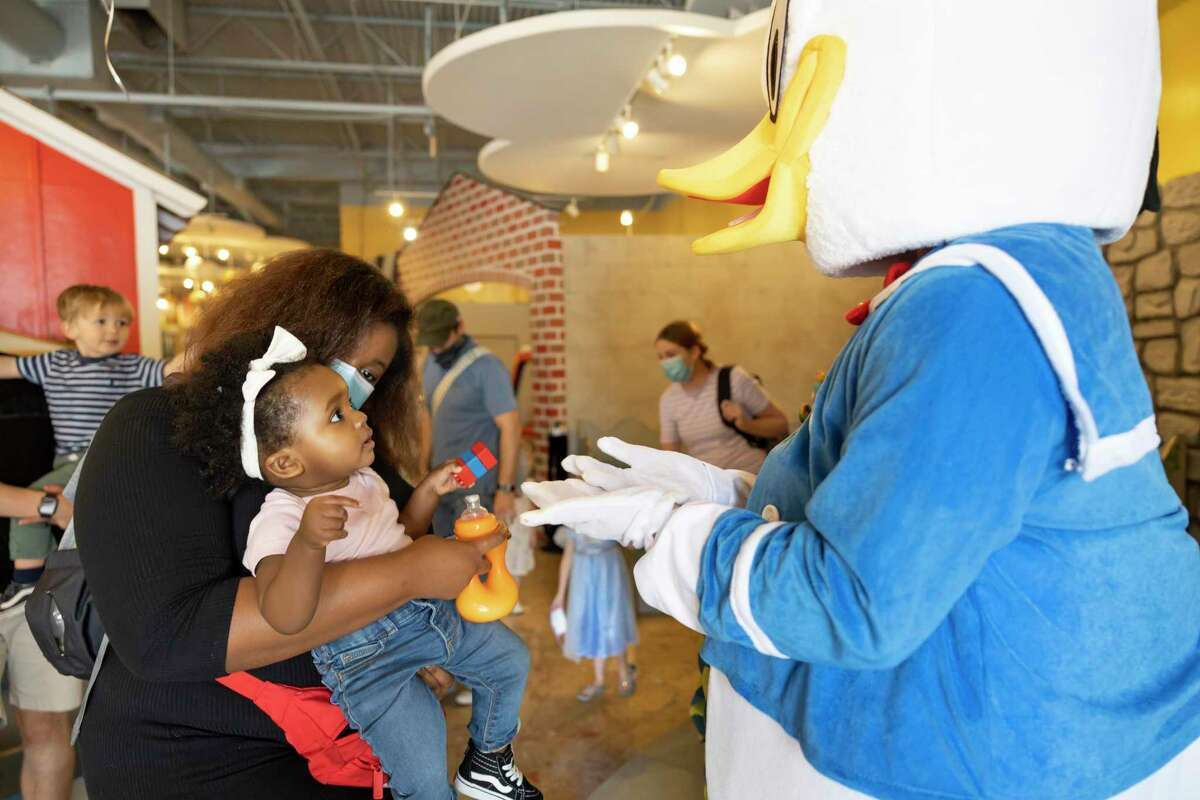 Brianna Warren introduces her 11-month-old daughter, Skylar to Donald Duck during Donald Duck's birthday at The Woodlands Children's Museum, Saturday, March, 13, 2021, in The Woodlands.