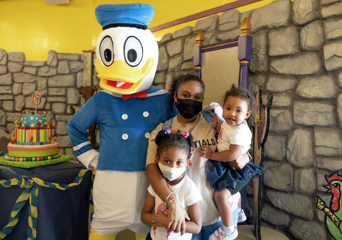 Sierra Hill, poses with her two children, Arjen and Kajer with Donald Duck during Donald Duck's birthday at The Woodlands Children's Museum, Saturday, March, 13, 2021, in The Woodlands.