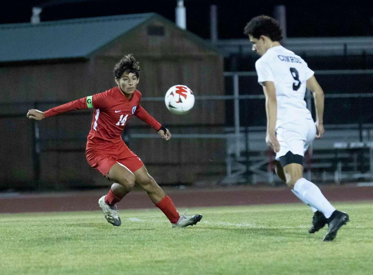 Conroe's David De La Paz (9) and The Woodlands midfielder Tomas Cabrales (14) are shown when the two teams played each other in February.