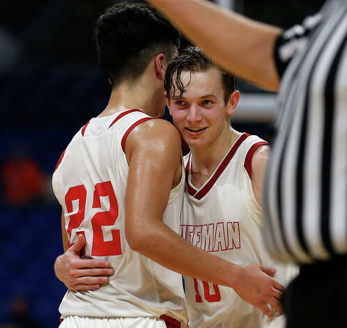 Huffman Hargrave Jacob Harvey #10 is hugged by Huffman Hargrave Jesse Viramontez #22 late in fourth quarter. Huffman vs. Argyle for Class 4A state basketball championship at the Alamodome on Saturday, March 13, 2021 Photo: Ronald Cortes/Contributor / 2021 Ronald Cortes