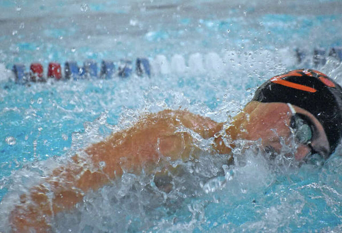 Edwardsville's Evan Grinter swims to victory in the 100-meter freestyle during the Region 4 Championships inside Chuck Fruit Aquatic Center.