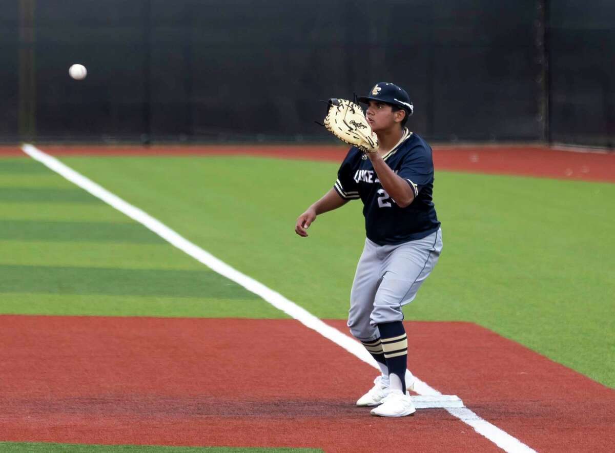 Lake Creek's Ethan Uribe (24), shown here earlier in the tournament, fields the ball at first base.