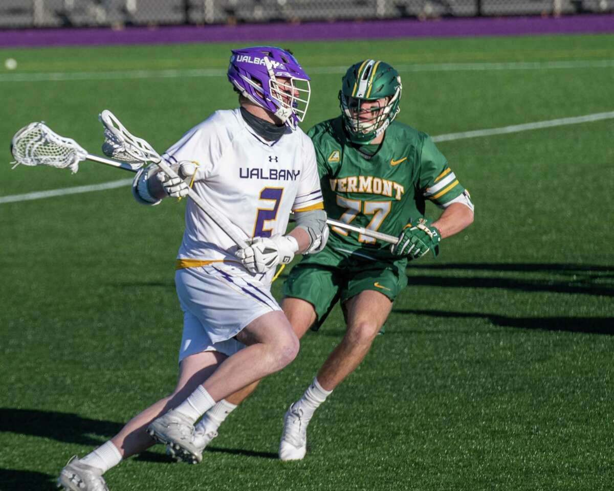 UAlbany senior Kyle Casey heads upfield in front of Vermont sophomore Nick Alviti at John Fallon Field on March 13. The Danes lost to the Catamounts twice during the regular season, by two goals each time. (Jim Franco/Special to the Times Union)