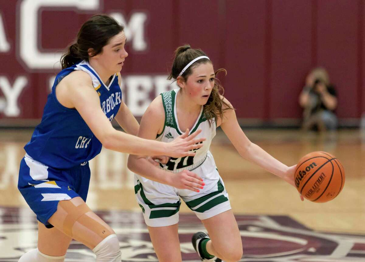 Legacy Prep guard Molly Steed (50) dribbles the ball while under pressure from Lubbock Christian center Brooke Hooten (33) during the second quarter of a TAPPS Class 4A girls state championship game at A&M Consolidated High School, Saturday, March 13, 2021, in College Station.