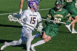 UAlbany graduate student Doug Goldsmith heads upfield in front of Vermont first year student Wilson Sneath at John Fallon Field on the UAlbany campus in Albany, NY, on Saturday, March 13, 2021 (Jim Franco/special to the Times Union.)