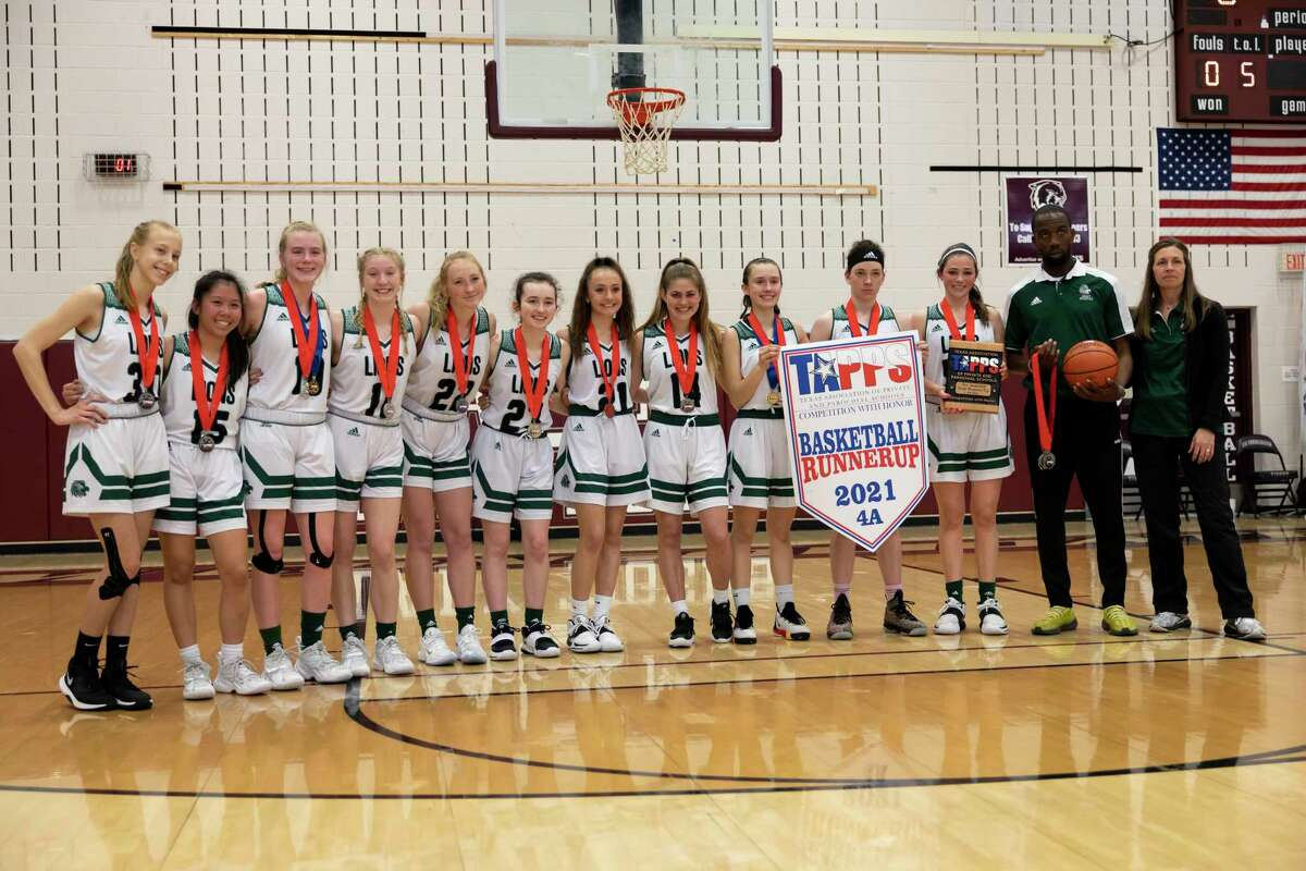 Legacy Prep girls basketball team pose for a portrait after receiving a TAPPS Class 4A girls state runner up championship banner at A&M Consolidated High School, Saturday, March 13, 2021, in College Station. Legacy Prep lost against Lubbock Christian School, 75-39.