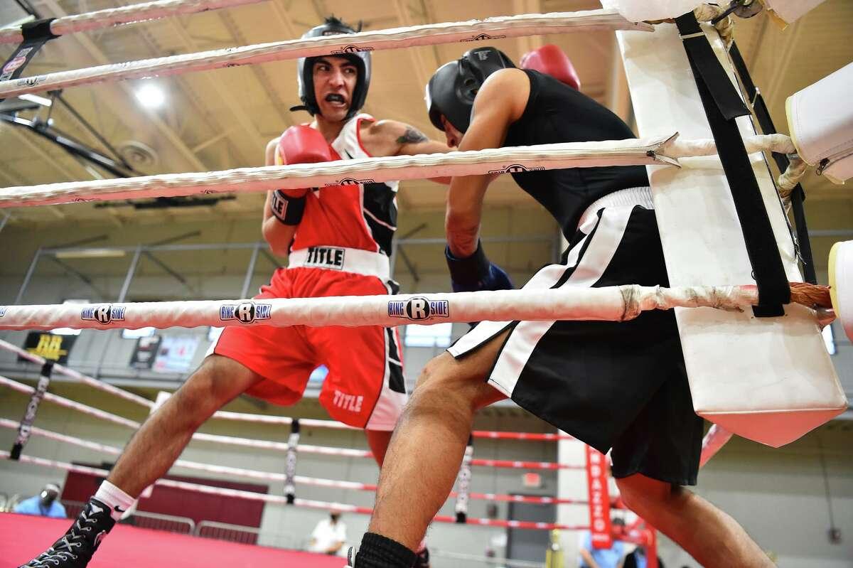 San Antonio's Joseph Hernandez fights Mark Rodriguez during the finals of the San Antonio Regional Golden Gloves tournament on Saturday at the George Gervin Wellness Center.