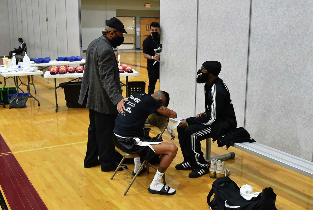 Director Ellis Johnson (standing) consols Isaac