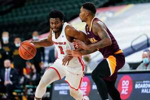 Fairfield's Taj Benning, left, dribbles past Iona's Berrick JeanLouis in the second half of the MAAC tournament championship on Saturday.