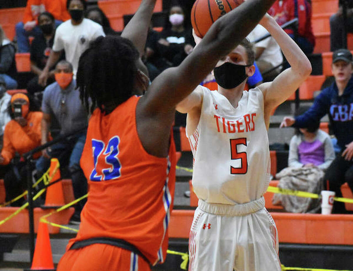 Edwardsville's Preston Weaver attempts a 3-pointer just before the fourth-quarter buzzer against East St. Louis on Saturday.