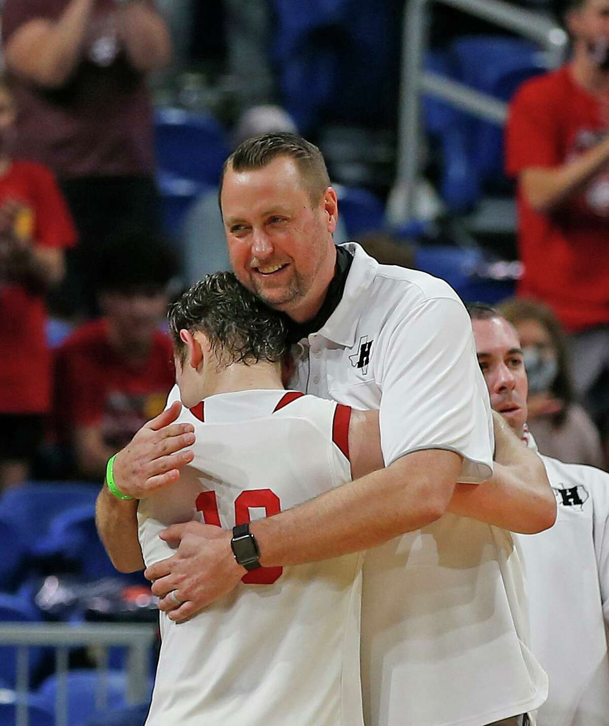 Huffman Hargrave Jacob Harvey #10 is huge by Huffman Hargrave head coach Scott Barrett at the end of the game. Huffman vs. Argyle for Class 4A state basketball championship at the Alamodome on Saturday, March 13, 2021