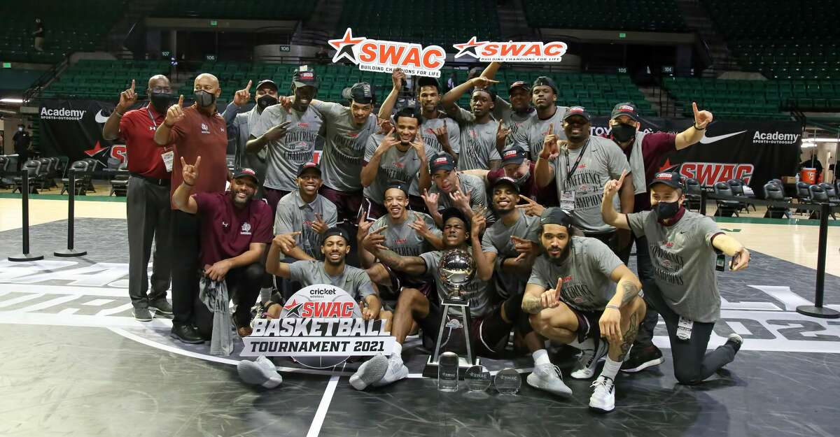 Texas Southern celebrates after defeating rival Prairie View A&M in the title game of the 2021 Cricket Wireless SWAC Basketball Tournament.
