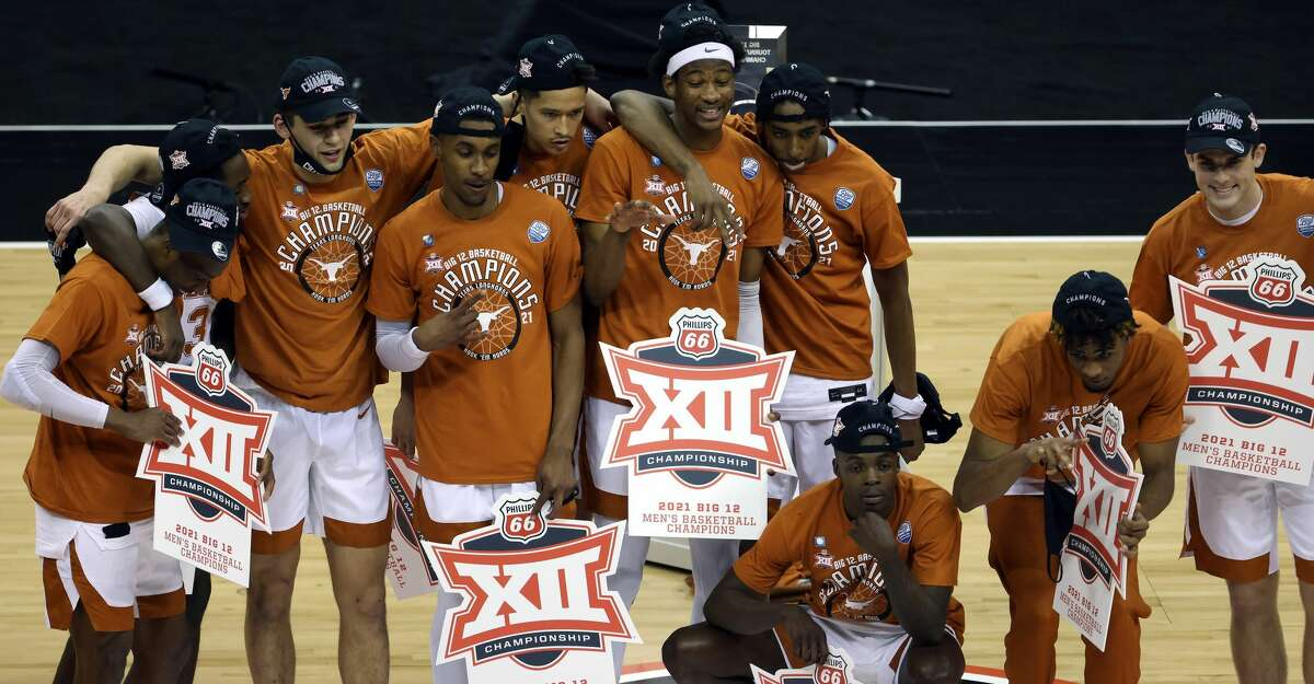 The Texas Longhorns celebrate after defeating the Oklahoma State Cowboys 91-86 to win the Big 12 Basketball Tournament championship game at the T-Mobile Center on March 13, 2021 in Kansas City, Missouri. (Photo by Jamie Squire/Getty Images)