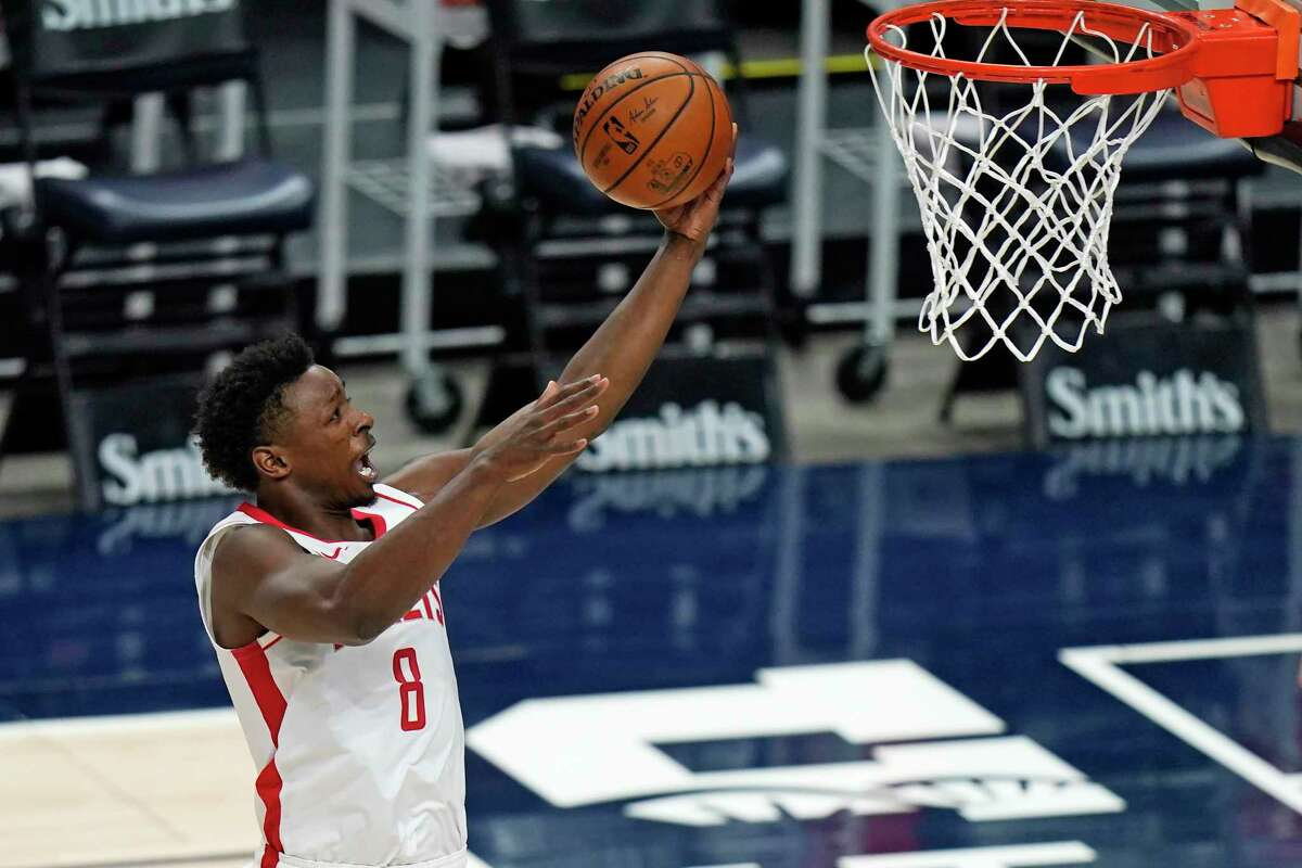 Houston Rockets forward Jae'Sean Tate lays the ball up during the first half of the team's NBA basketball game against the Utah Jazz on Friday, March 12, 2021, in Salt Lake City. (AP Photo/Rick Bowmer)