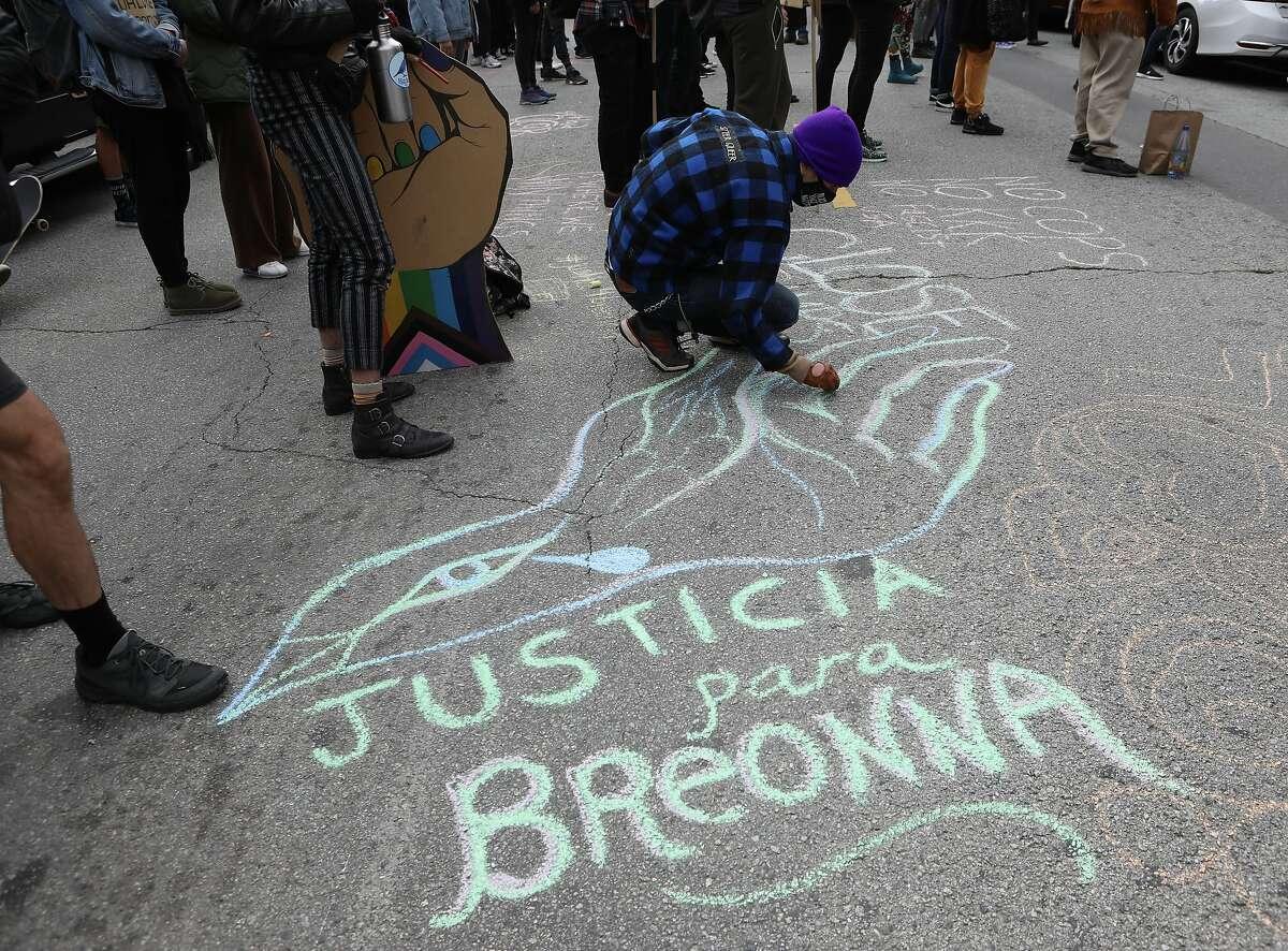 Sage Dames draws a memorial to Breonna Taylor.