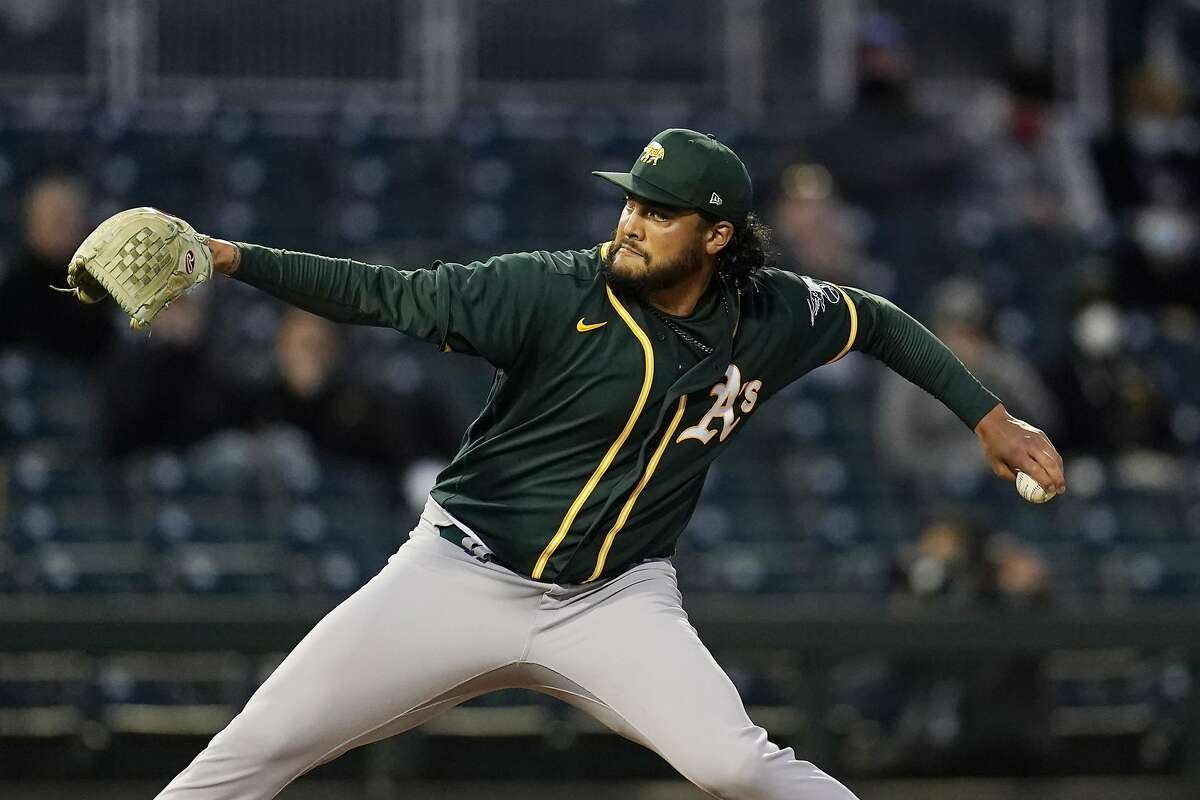 Oakland Athletics starting pitcher Sean Manaea throws to a Cincinnati Reds batter during the second inning of a spring training baseball game Saturday, March 13, 2021, in Goodyear, Ariz. (AP Photo/Ross D. Franklin)