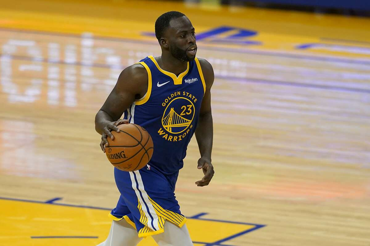 Golden State Warriors forward Draymond Green (23) against the Charlotte Hornets during an NBA basketball game in San Francisco, Friday, Feb. 26, 2021. (AP Photo/Jeff Chiu)