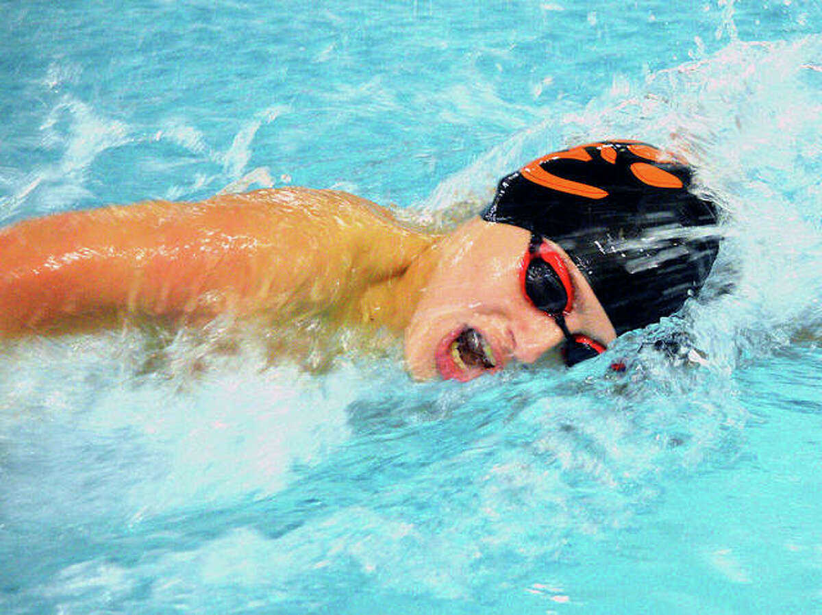 Edwardsville's Evan Grinter won the 50-yard and 100-yard freestyle races and was on the Tigers' second-place 400-yard freestyle relay team at Saturday's Region 4 Championship Meet at the Chuck Fruit Aquatic Center.