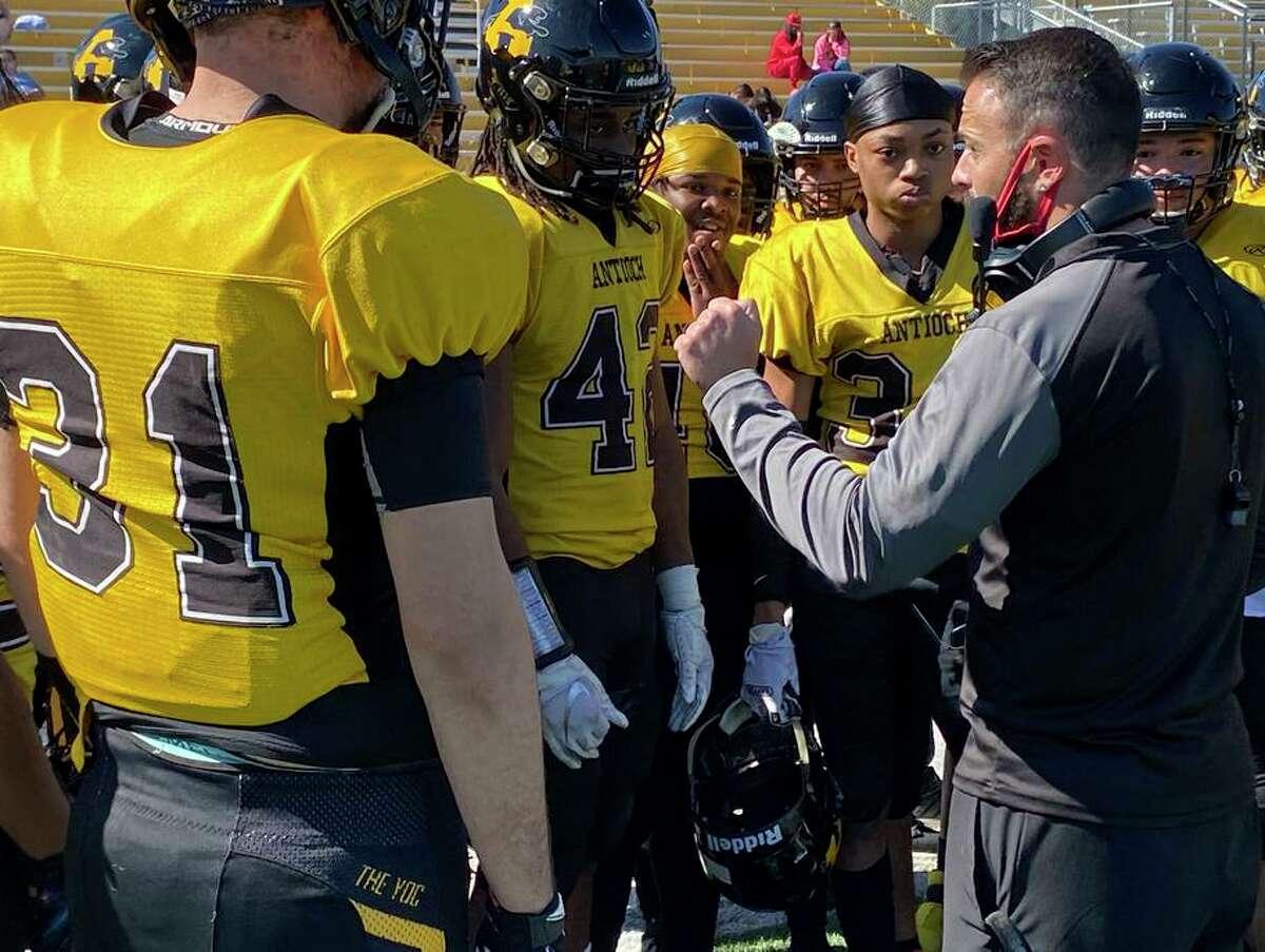 Antioch offensive coordinator coach Brett Dudley addresses team.
