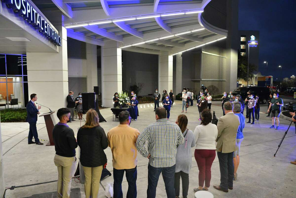 Methodist Hospital CEO Dan Miller speaks during a candlelight vigil outside the main entrance to the hospital at 7700 Floyd Curl on Saturday night. The hospital has treated more than 3,200 people with COVID-19 since it received its first patient with the disease on March 13, 2020.