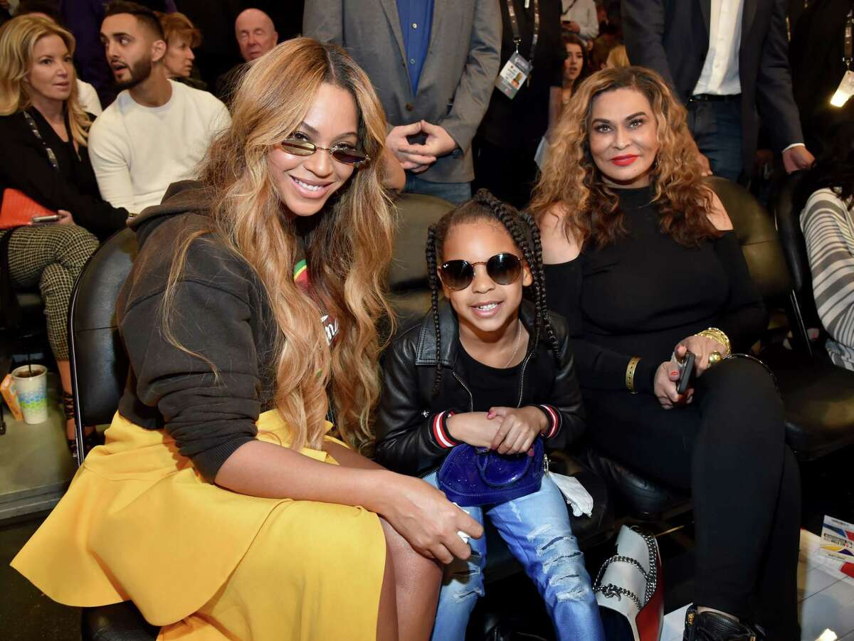 Beyonce, Blue Ivy Carter, and Tina Knowles Lawson attend the NBA All-Star Game at Staples Center in 2018.