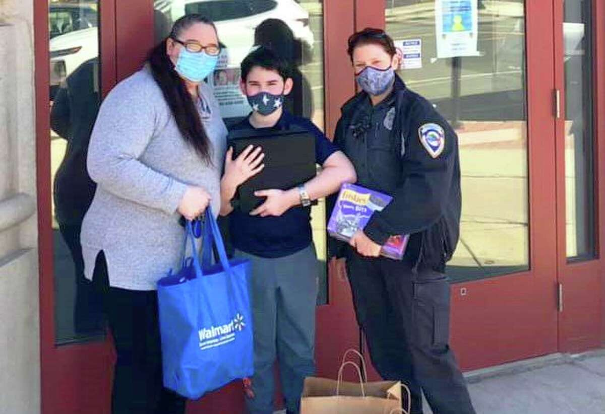 From left are Nicole Sibley and her 10-year-old son Zane Alwashah in front of the Middletown Police Department Friday with Senior Animal Control Officer Gail Petras. She organized a fundraising effort to help the family after they suffered two fires within a month. They lost all their belongings.