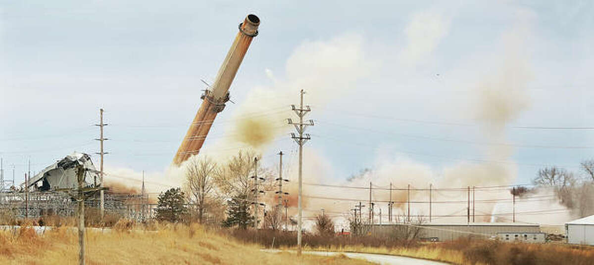 After lingering for a few seconds, the third and final smokestack at the former Dynegy power plant in East Alton collapses to the ground shortly around 7:43 a.m. Sunday.