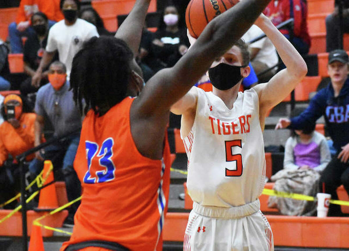 Edwardsville's Preston Weaver (5) attempts a 3-pointer that does not fall in the final seconds of the Tigers loss to East St. Louis on Saturday at Lucco-Jackson Gym in Edwardsville.