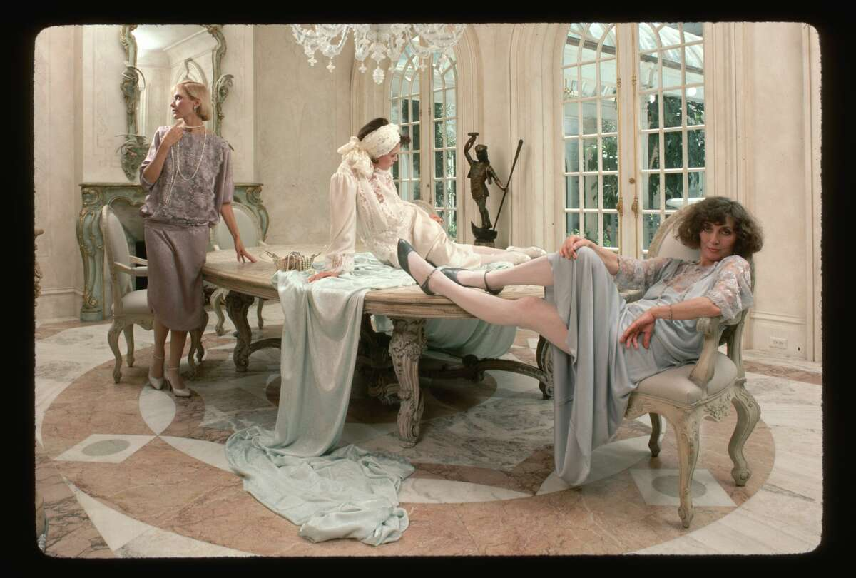 Designer Jessica McClintock and models pose with some of her fashions at her San Francisco home in 1984.