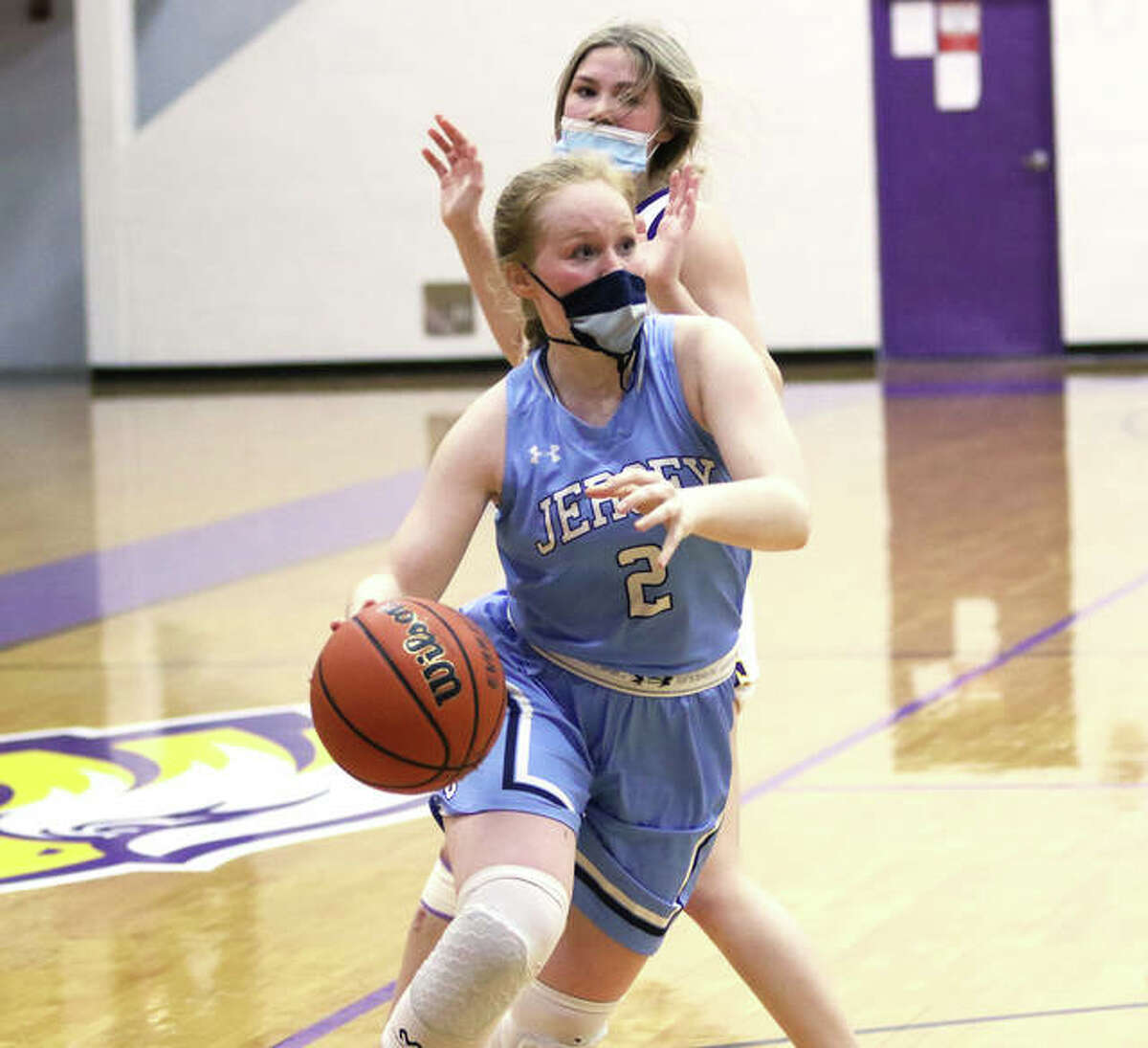 Jersey's Sally Hudson (2) drives past CM's Maura Niemeier in a Feb. 22 game at Bethalto. Hudson, a senior, scored 11 points in her final game Saturday.
