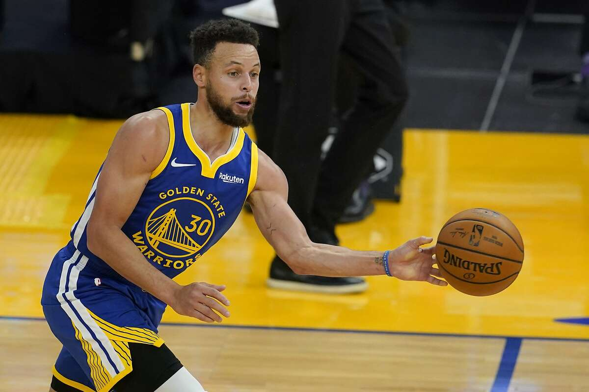 Golden State Warriors guard Stephen Curry (30) against the Charlotte Hornets during an NBA basketball game in San Francisco, Friday, Feb. 26, 2021. (AP Photo/Jeff Chiu)