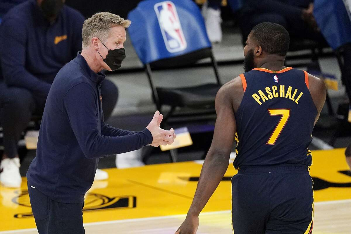 Golden State Warriors head coach Steve Kerr, left, has words with forward Eric Paschall during the first half of an NBA basketball game against the Los Angeles Lakers Sunday, Feb. 28, 2021, in Los Angeles. (AP Photo/Mark J. Terrill)