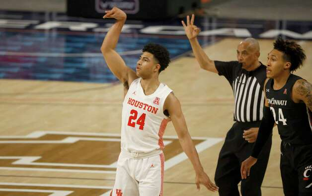 Houston guard Quentin Grimes (24) attempts a 3-point shot as Cincinnati guard Jeremiah Davenport (24) looks on during the first half of an NCAA college basketball game in the final round of the American Athletic Conference men's tournament Sunday, March 14, 2021, in Fort Worth, Texas. (AP Photo/Ron Jenkins) Photo: Ron Jenkins, Associated Press / Copyright 2021 The Associated Press. All rights reserved.