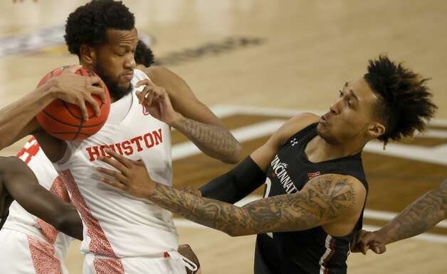Houston forward Justin Gorham (4) and Cincinnati guard Jeremiah Davenport (24) fight for a rebound during the second half of an NCAA college basketball game in the final round of the American Athletic Conference men's tournament Sunday, March 14, 2021, in Fort Worth, Texas. (AP Photo/Ron Jenkins) Photo: Ron Jenkins/Associated Press / Copyright 2021 The Associated Press. All rights reserved.