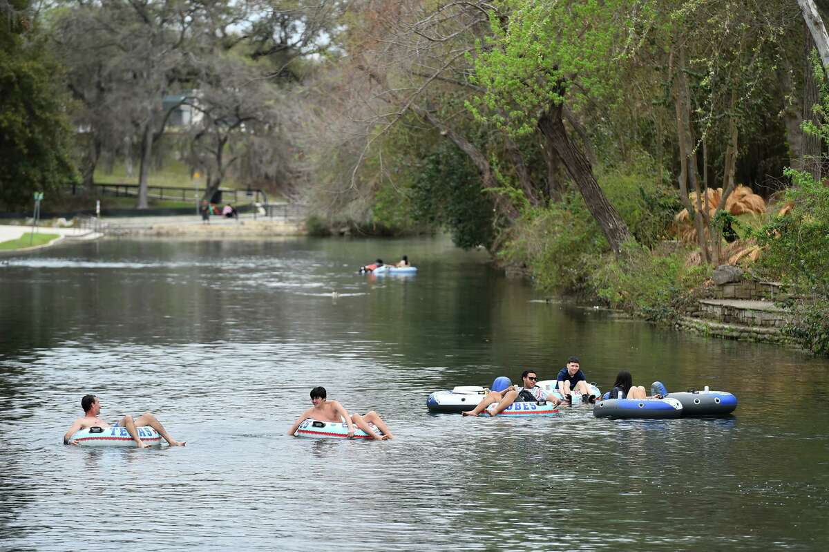People cruise the Comal River in New Braunfels in March, when tubing season began. Heavy rains overnight spurred New Braunfels Police Department to close the Comal River on Saturday.