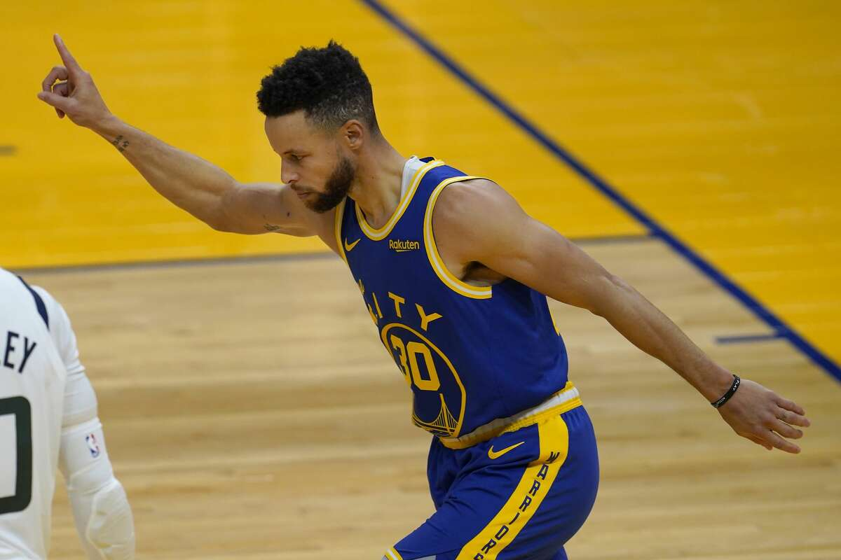 Golden State Warriors guard Stephen Curry reacts after shooting a 3-point basket against the Utah Jazz on March 14, 2021.