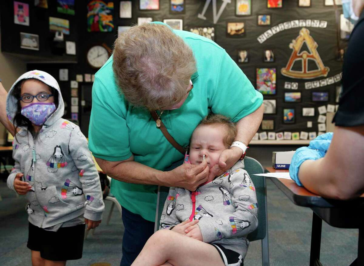 Lamar Campos swabs the nose of her granddaughter Myra Campos, 3, as part of her Covid-19 test. Community Labs provided weekend COVID-19 testing on Sunday, March 14, 2021, as some schools prepare to return to class after spring break.