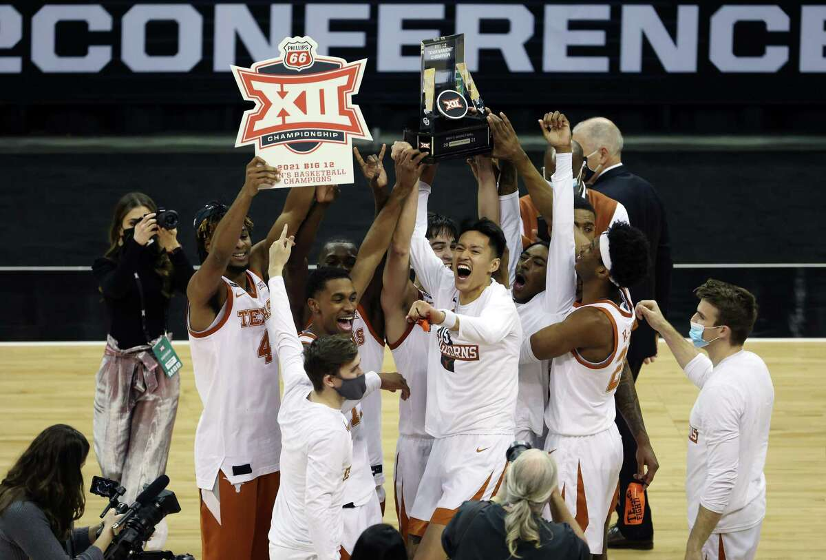 Texas players celebrate the program's first Big 12 tournament championship Saturday after beating Oklahoma State at the T-Mobile Center in Kansas City, Mo. The Longhorns' No. 3 seed in the East is the highest since they were No. 4 in 2011.