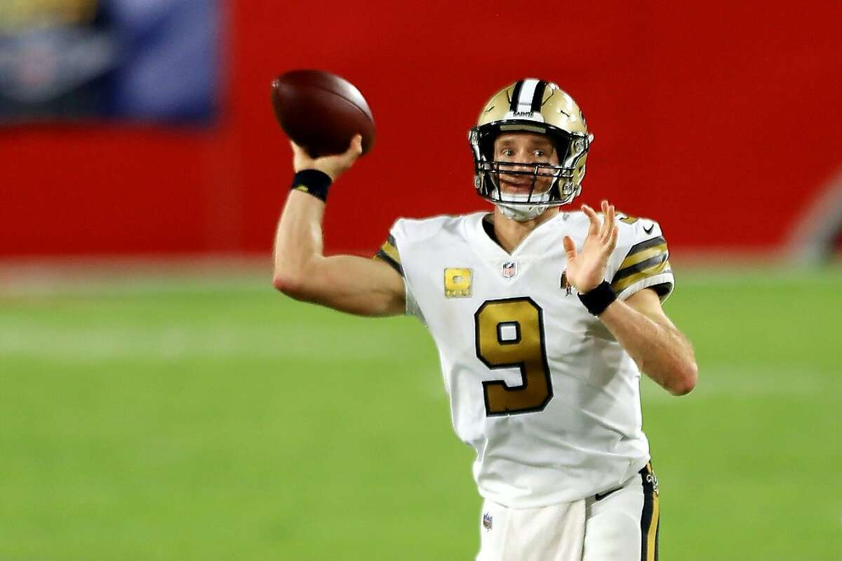 New Orleans Saints quarterback Drew Brees throws a pass during the first half against the Tampa Bay Buccaneers in Tampa, Florida