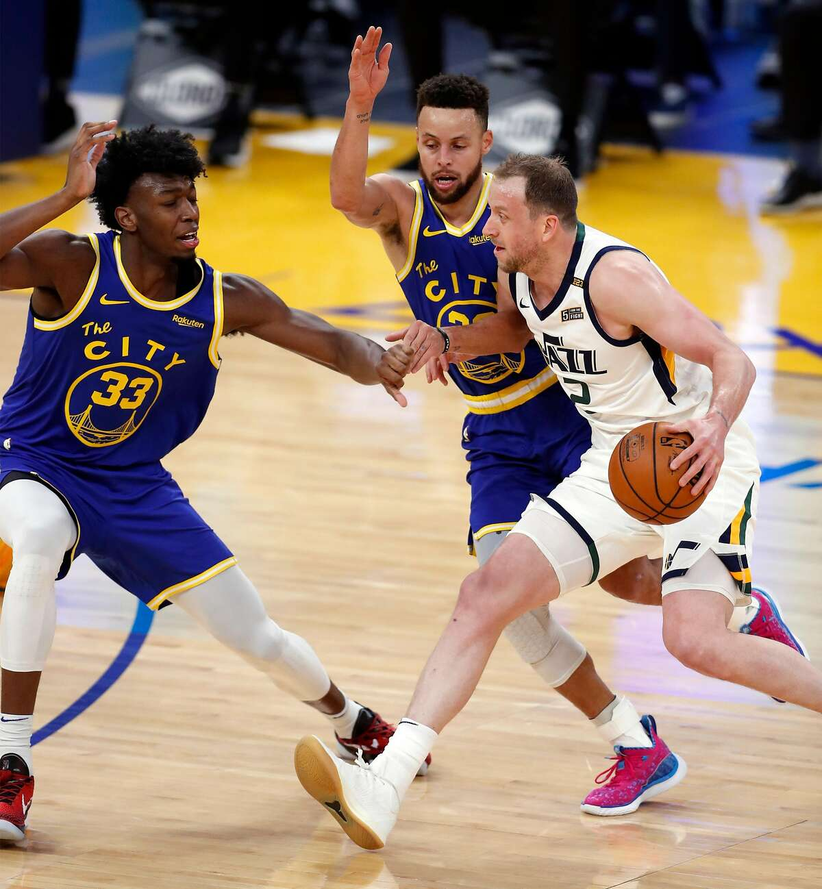 Golden State Warriors' James Wiseman and Stephen Curry guard Utah Jazz' Joe Ingles in 1st quarter during NBA game at Chase Center in San Francisco, Calif., on Sunday, March 14, 2021.