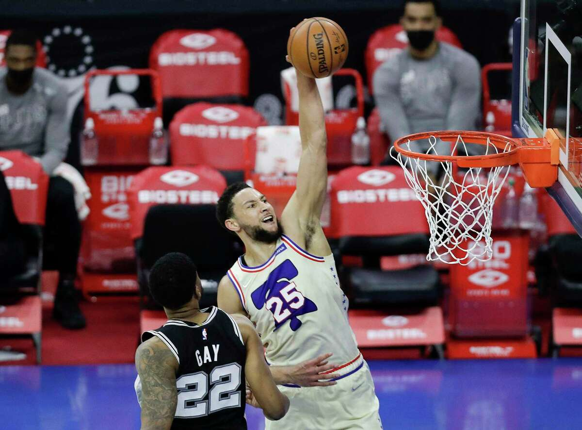 Philadelphia 76ers guard Ben Simmons rises to dunk over San Antonio Spurs forward Rudy Gay in the second quarter on Sunday, March 14, 2021 at Wells Fargo Center in Philadelphia, Pennsylvania. (Yong Kim/The Philadelphia Inquirer/TNS)