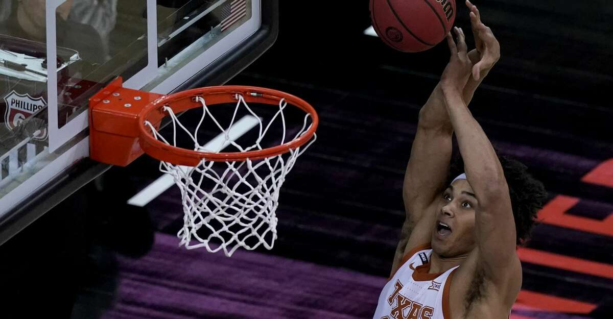 Texas's Jericho Sims puts up a shot during the first half of an NCAA college basketball game against Oklahoma State for the Big 12 tournament championship in Kansas City, Mo, Saturday, March 13, 2021. (AP Photo/Charlie Riedel)