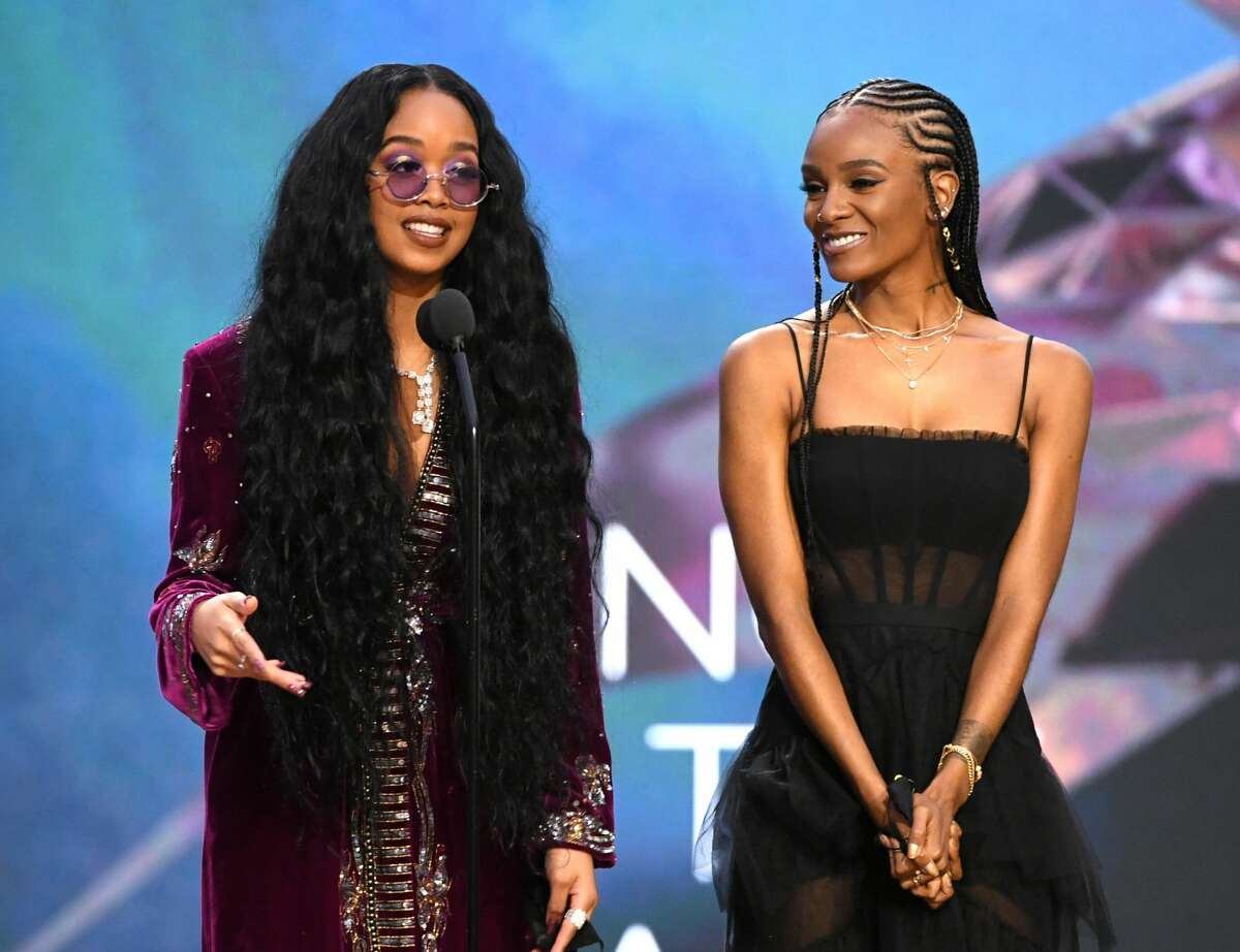 H.E.R. and Tiara Thomas accept the Song of the Year award for 'I Can't Breathe' onstage during the 63rd Annual GRAMMY Awards at Los Angeles Convention Center on Mar. 14, 2021.