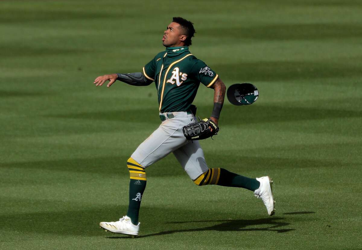 Buddy Reed (7) rus for a fly ball that fell in shallow center/right field in the fifth inning as the Oakland Athletics played the Colorado Rockies at Salt River Fields at Talking Stick in Scottsdale, Ariz., on Wednesday, March 3, 2021.